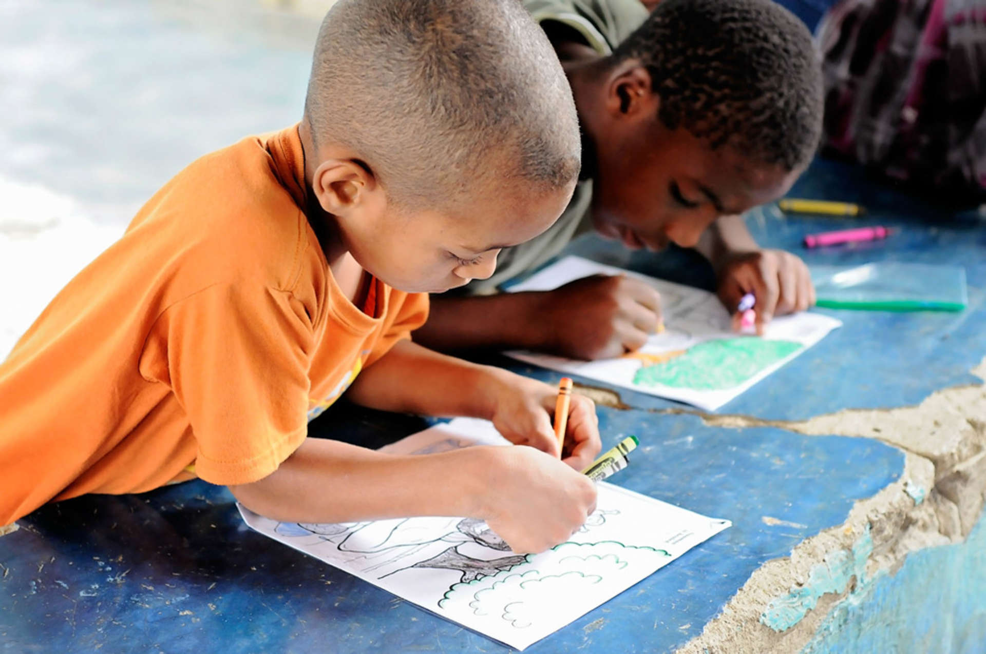 Young Dominican boys colouring